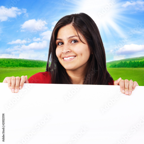 Woman Holding White Sign Up on a Sunny Day