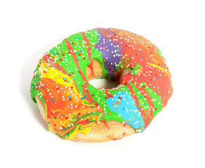 a colorful glazed donut with speckles on top