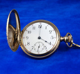 Face of antique gold pocket watch