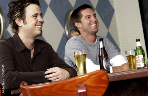 Two men drinking at a bar