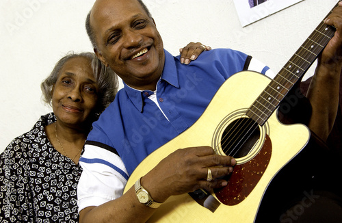 African American couple with man playing guitar