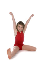 girl in red leotard doing split on high key background