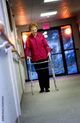 Senior woman walking with walker