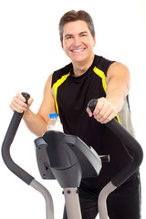 Smiling strong man working out. Isolated over white background.