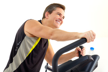 Smiling mature man working out. Isolated over white background.