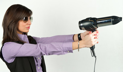 Hairdryer gun holding by a woman