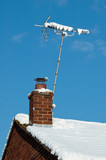 snow covered television antenna on a rooftop poster