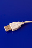 USB connection cable isolated on blue background poster