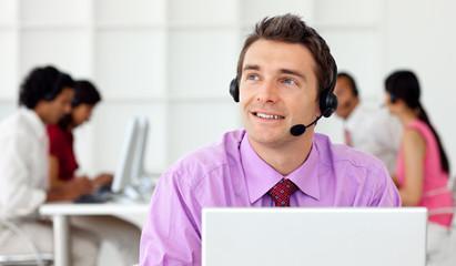 Smiling businessman talking on headset