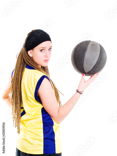young woman playing game with basketball over white