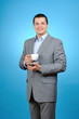Handsome businessman holding a cup of coffee