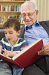 senior and child reading