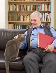senior man and cat