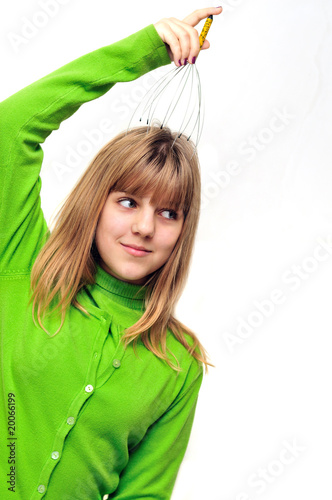 Teen girl using head scalp massage