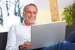 Mature man having fun with laptop