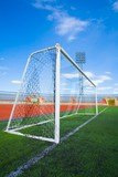 STADIUM - Football field with goal  on blue sky poster
