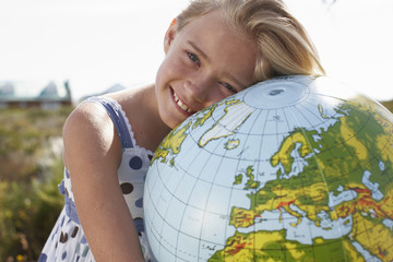 Happy girl with a globe