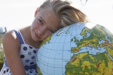 Girl with a globe portrait