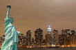 New York City Skyline and The Statue of Liberty at Night