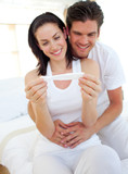 Smiling couple finding out results of a pregnancy test
