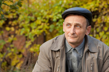 Thoughtful middleaged man in autumnal garden
