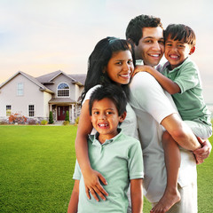 Modern Family Smiling in Front of Home