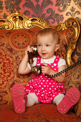 Little girl talking vintage phone. Interior in retro style