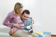Happy pregnant young couple with baby sonogram