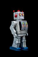 Toy robot on black background