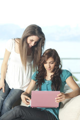 Happy young women with netbook