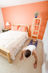 Man Doing Push-Ups in Bedroom
