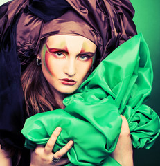 Woman and green fabric