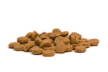Pile of dog food bits on a white background
