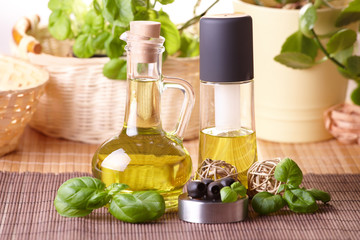 Two bottles with olive oil and grape seed oil