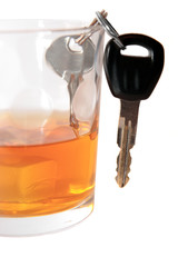 car keys inside bourbon glass