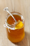 orange   thin cut marmalade or jam on a spoon in a jar poster