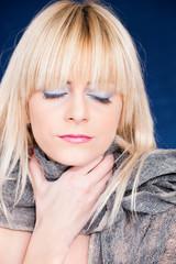 blond woman feeling sick