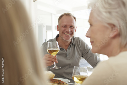 Happy man with a glass of wine