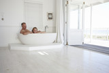 Couple relaxing in a bathtub