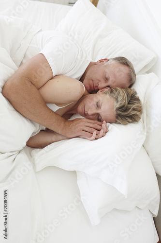 Attractive couple sleeping