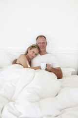 Happy couple in the bed