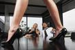 Businessmen looking at legs