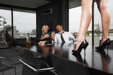 Businessmen drinking whisky