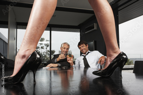 Corporate men celebrating