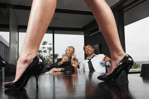 Businessmen looking at legs