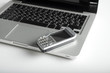 mobile phone over laptop keyboard