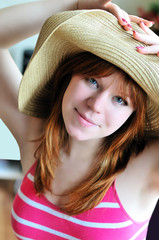 pretty girl wearing straw hat