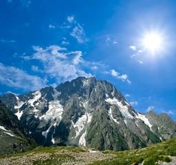 sparkle sun above a great mountain