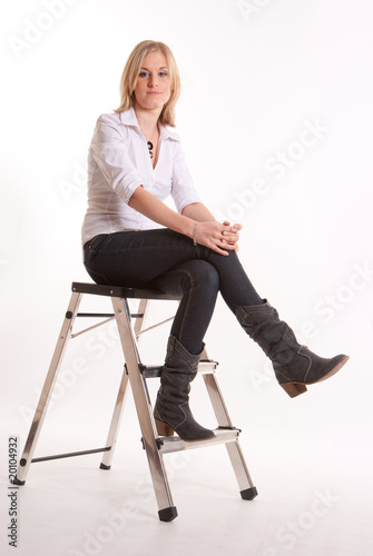 Girl sitting on a stepladder