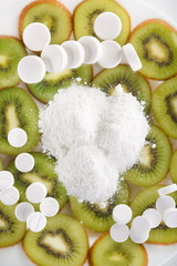 white pills with kiwi fruit.